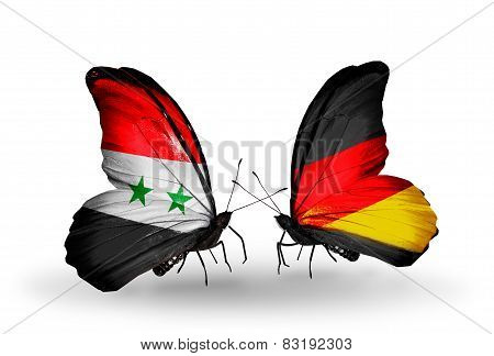 Two Butterflies With Flags On Wings As Symbol Of Relations Syria And Germany