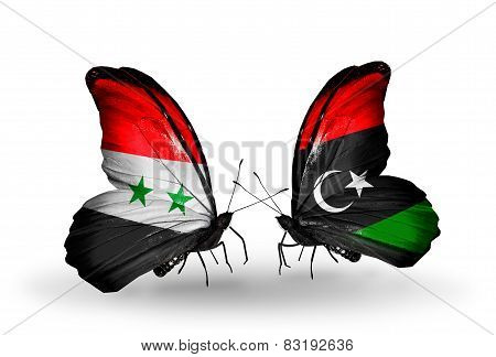 Two Butterflies With Flags On Wings As Symbol Of Relations Syria And Libya