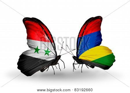 Two Butterflies With Flags On Wings As Symbol Of Relations Syria And Mauritius
