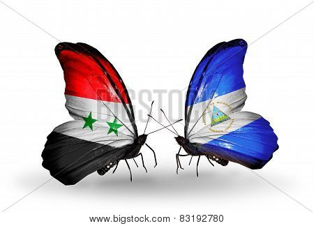 Two Butterflies With Flags On Wings As Symbol Of Relations Syria And Nicaragua