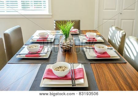 Contemporary dining room table set for dinner