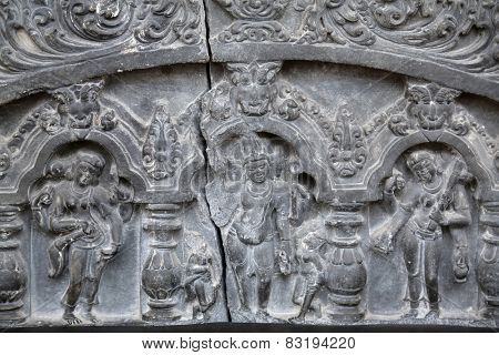 KOLKATA, INDIA - FEBRUARY 15: Brahma and other deities, from 11th century found in Basalt, Gaur, West Bengal now exposed in the Indian Museum in Kolkata, on February 15, 2014