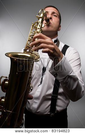 Closeup Portrait Of Playing Saxophonist. Wide Angle