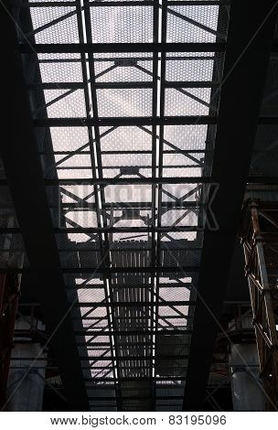 Bridge Construction. Metal Mesh Framework Of The Bridge