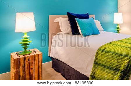 Modern blue bedroom interior in a luxury house with reclaimed wood bedside tables