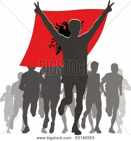 Athlete with the Albania flag at the finish
