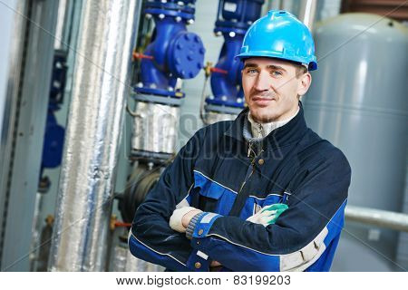 industrial heat engineer worker plumber at boiler room