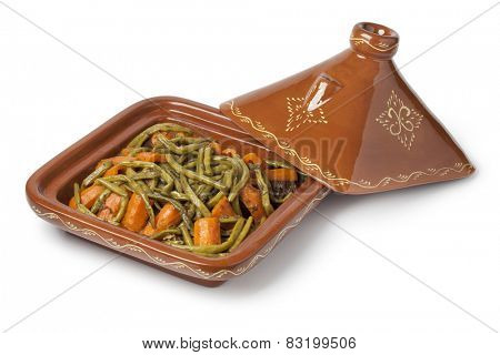 Moroccan square tagine with meat, green beans and carrots on white background