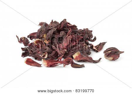 Heap of dried hibiscus flowers on white background