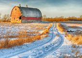 foto of red barn  - This red barn landscape with a portion of a broken wall collapsing on one corner is Photographed in stunning High dynamic range on a sunny mid morning in rural mid west  - JPG