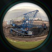 pic of objectives  - Excavator in surface coal mine in objective lens  - JPG