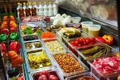 foto of pickled vegetables  - Variety of pickled vegetables and mushrooms in a store - JPG