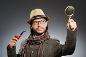 stock photo of private investigator  - Funny detective with smoking pipe and magnifying glass - JPG