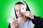 foto of nun  - Nun in the gambling concept - JPG