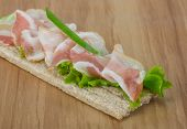 stock photo of baps  - Bacon sandwich with crisp and salad leaves - JPG