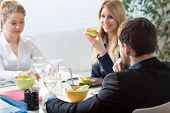 picture of assemblage  - Three businesspeople eating healthy snacks for brunch - JPG