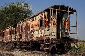 picture of covered wagon  - The old train on the rail cover by plant and sky - JPG