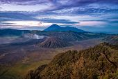 stock photo of bromo  - Wideangle view of mount bromo crater around sunrise - JPG