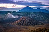 picture of bromo  - Bromo crater with smoke coming out in the early morning - JPG
