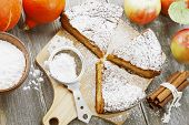 foto of pumpkin pie  - Pumpkin pie with apples and cinnamon on the wooden table - JPG