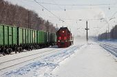 picture of locomotive  - red locomotive rides the rails in winter - JPG