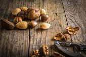 stock photo of nutcracker  - steel nutcracker and nuts of various kinds - JPG