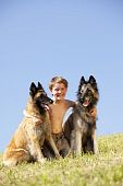 smiling boy with two dogs