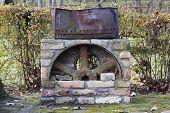 pic of brazier  - Retro vintage rusty iron barbecue brazier concept - JPG