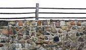 picture of fragmentation  - Fragment old granite wall of a medieval castle isolated - JPG