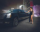 image of limousine  - Rich woman touches and admires her limousine - JPG