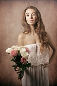 stock photo of charming  - Beautiful young charming gorgeous girl with curly hairstyle and bouquet of roses - JPG