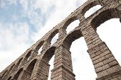 stock photo of aqueduct  - an old stone aqueduct in Segovia Spain - JPG