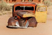 pic of wrecking  - An old car wreck lying in the desert - JPG