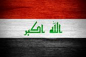 image of iraq  - Iraq flag or Iraqi banner on wooden texture - JPG