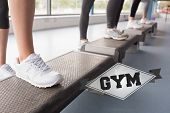stock photo of step aerobics  - The word gym and womens feet stepping in aerobics class against badge - JPG