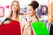 foto of boutique  - Women shopping in boutique or fashion store buying fashion - JPG