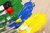 picture of paint palette  - paint brushes with paint on wooden palette - JPG