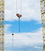 image of mast  - Masts and hooks of the tower cranes - JPG