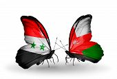 stock photo of oman  - Two butterflies with flags on wings as symbol of relations Syria and Oman - JPG