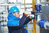 image of boiler  - industrial heat engineer worker plumber at boiler room installation - JPG