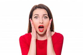 stock photo of shock awe  - Adorable woman with red lipstick standing in awe looking at camera with mouth and eyes open wide surprised isolated on white background - JPG