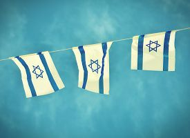 pic of star shape  - Israel flags in a chain in white and blue showing the Star of David hanging proudly for Israel - JPG