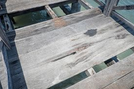 pic of unsafe  - Unsafe boardwalk over the sea with missing parts