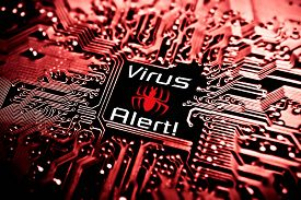 image of virus scan  - a symbol of a computer virus on a circuit board - JPG