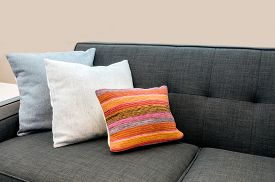 stock photo of couch  - Interior design with couch sofa with colorful cushions pillows - JPG
