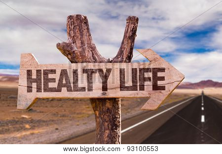 Healthy Life direction sign with road background