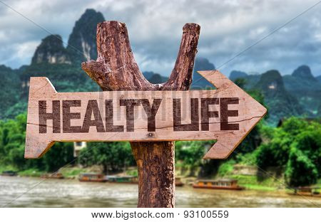 Healthy Life direction sign with exotic background