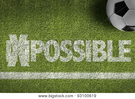 Soccer field with the text: Impossible/Possible