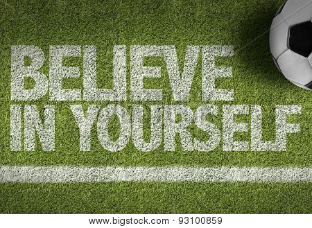 Soccer field with the text: Believe in Yourself