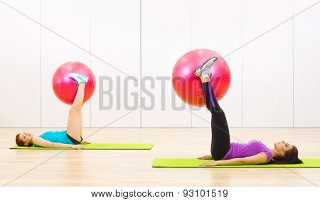 Two young sporty women at fitness club